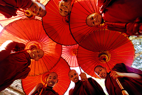 monks with parasols